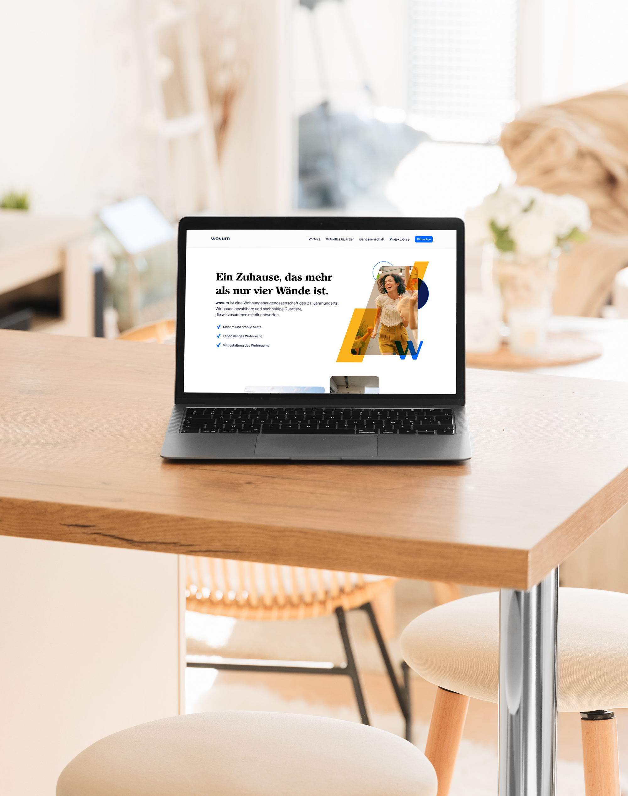 The image shows a laptop mockup showcasing the title page of the wovum landing page design.