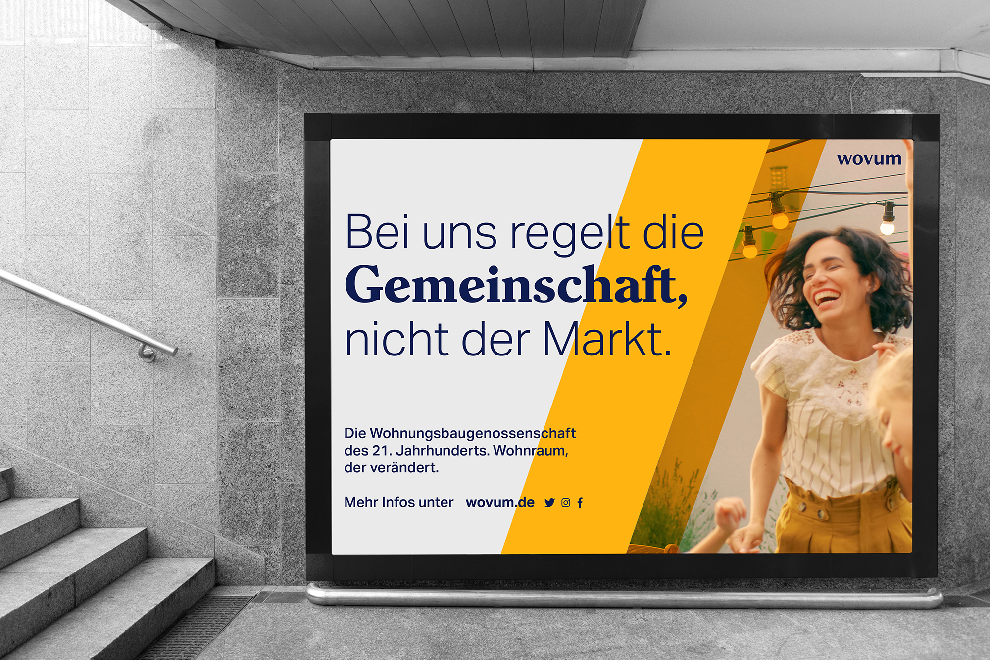 The image shows a photograph of a wovum billboard in a subway station entrance.